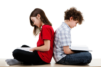 Girl and boy reading book isolated on white background